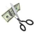 scissors clipping hundred dollar bill